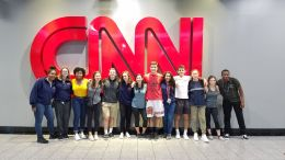team picture in front of the CNN sign at CNN center