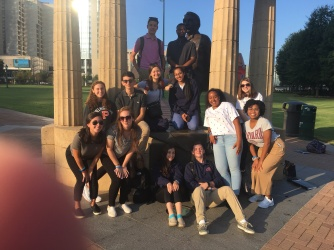 team picture with statue in Centennial Park