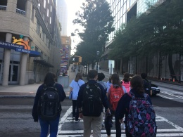 team walking to Drew Eckl & Farnham in Downtown Atlanta